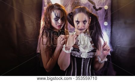 Girl With Halloween Makeup Is Sitting In Front Of A Mirror. Makeup Of The Actor. The Girl In The Ima