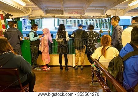 HONG KONG, CHINA - CIRCA JANUARY, 2019: people on a Star Ferry. The Star Ferry is a passenger ferry service operator and tourist attraction in Hong Kong.