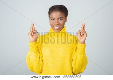 Cheerful Young Woman Showing Cross Fingers Gesture. Attractive Lady Wanted To Make Her Wishes Come T