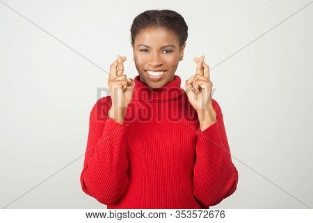 Smiling Young Woman Showing Cross Fingers Gesture. Attractive Lady Wanted To Make Her Wishes Come Tr
