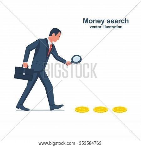 Search For Money. Businessman Is Looking Through A Magnifying Glass. Search For Profits. Coins On Th