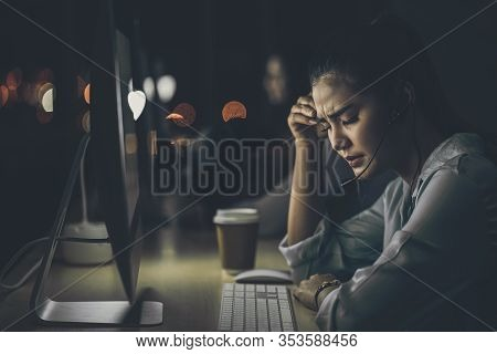 Asian Business Woman Working Hard Late With Her Technology Computer In Office, Customer Service And