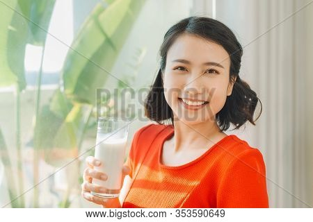 Close Up Portrait Young Asian Pregnant Woman Holding A Glass Of Milk