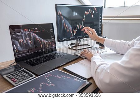 Stock Exchange Market Concept, Business Investor Trading Or Stock Brokers Having A Planning And Anal