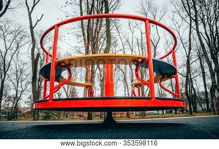 Rides On The Playground. Centrifuge, Swing For Children. Wheel Bottom View In  Red.