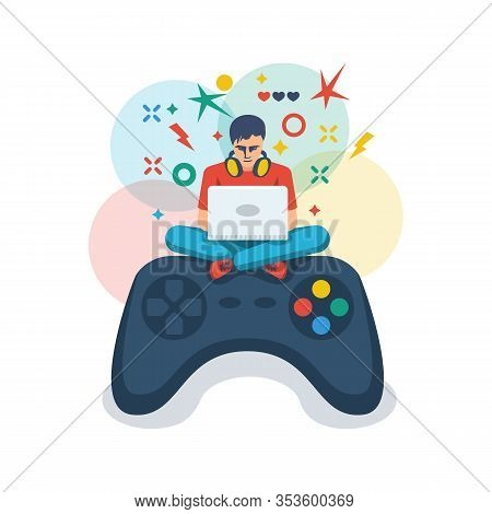 Video Game, Playing Online. Gamer With A Laptop Sits On A Big Joystick. Young Guy Is Playing An Onli