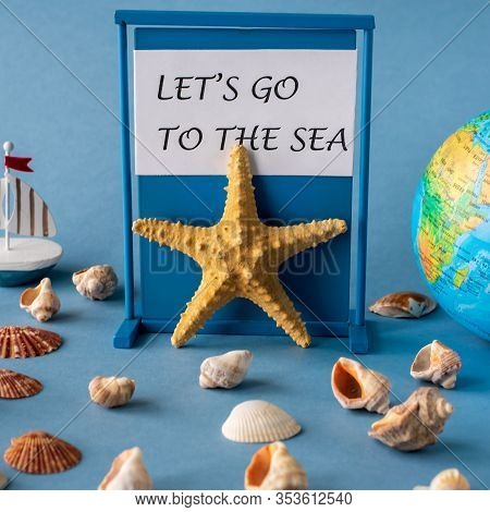 Globe, Starfish And Shells On A Blue Background With Typography Lets Go To The Sea.