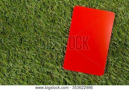 Soccer Sports Referee Red Card On Grass Background - Penalty, Foul Or Sports Concept, Top View Flat