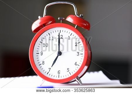 Close Up Table Red Alarm Clock Meeting Deadlines. An Alarm Clock Helps To Oversleep Right Time And N