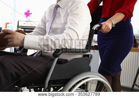 Woman Carries Man In Suit On Wheelchair Workplace. Person Moves On Wheelchair. Interview Invitation.