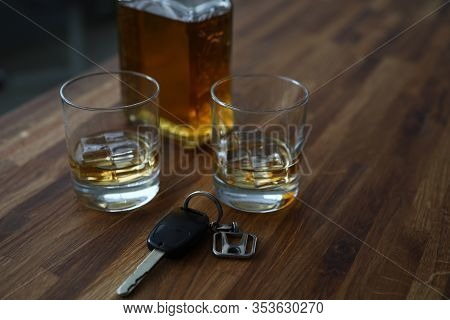 Car Key Lies On Table Next To Bottle Alcohol. Permissible Rate Alcohol While Driving. Drivers Are Te