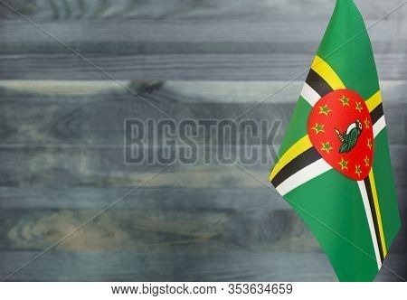 Fragment Of The Flag Of The Commonwealth Of Dominica In The Foreground Blurred Light Background Copy