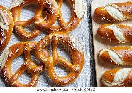 Closeup Photo Of Lye Bun And Bavarian Pretzel In Bakery