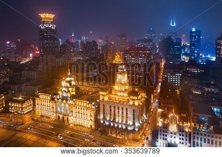 Shanghai bund aerial night view from above with city skyline and skyscrapers in China.