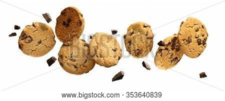 Chocolate Chip Cookies With Pieces Of Chocolate Flying Or Falling Over White Background