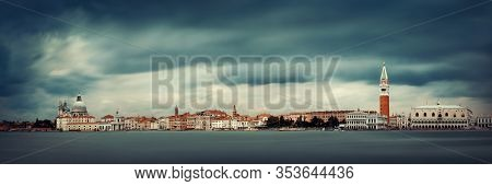St Marks church clock tower and city skyline panorama viewed from San Giorgio Maggiore island in Venice, Italy.
