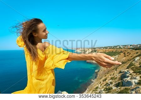 Happy Atractive Taned Woman Making Selfie And Smile To The Camera On Cliff Edge With Beautiful Sea V