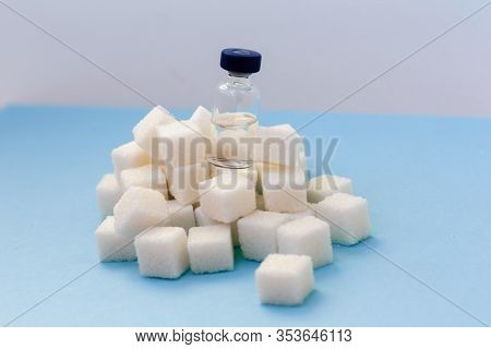 Sugar Addiction, Insulin Resistance, Unhealthy Diet, Sugar Cubes And Bottles Of Insulin On Blue Back