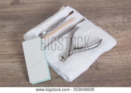 A Set Of Tools For Manicure On A White Towel. Nail Care, Procedure, Nail Salon. Tweezers, Wire Cutte