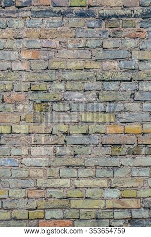 Aged Dirty Brickwall. Background Of Old Brick Wall. Pastel Colors Wall Of Bricks. Vertical Orientati