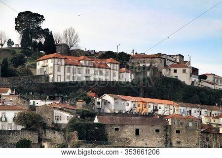 Old Facades Of Port Wine Cellars And Restaurants In Vila Nova De Gaia In Oporto, Portugal