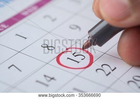 Close Up Of Man Hand Circle Calendar Date