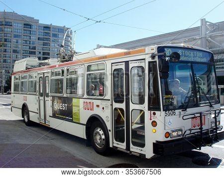 San Francisco - February 19, 2007: Muni Trolley Bus 30 - Stockton With Ad On Side Crosses Howard Str