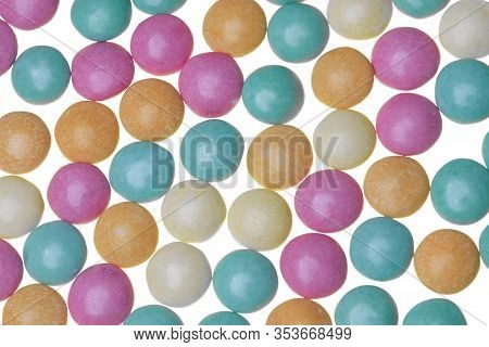 Pastel Green, Orange, Pink And Yellow Sugar-coaged Chocolate Candy In The Shape Of Oblate Spheroid