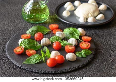 Caprese Salad Made Of Mozzarella, Tomatoes, And Sweet Basil