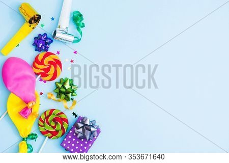 Concept For Holiday Party, Carnival, Party, Festive Sales. Birthday Blue Background With Colorful Bo