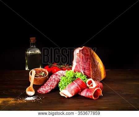 Authentic Italian Prosciutto Dry-cured On Wooden Background. Air-dried Ham. Close-up, Copy Space