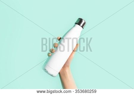 Close-up Of Female Hand, Holding White Reusable Steel Stainless Eco Thermo Water Bottle With Mockup,