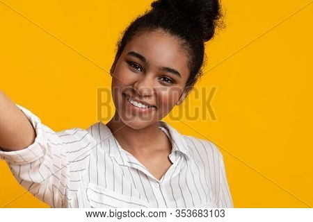 Positive Selfie. Pretty Afro Girl Taking Self-portrait, Capturing Photo, Smiling At Camera, Posing O