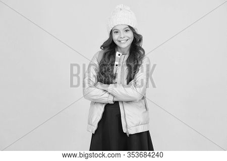 Regular Schoolgirl. Girl Smiling Face Little Fashionable Cutie Wear Knitted Hat And Jacket. Modern O