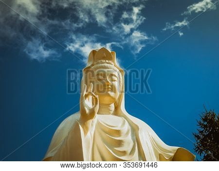 Spectacular Cloud Over The Statue Of Guanyin, The Goddess Of Mercy And Compassion In The Buddhist Re