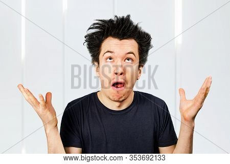 Young White Caucasian Guy Long Hair Shrug His Shoulders And Looking Up On A White Background