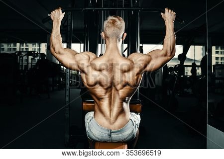 Fitness Men Doing Pull-ups Exercises In Gym