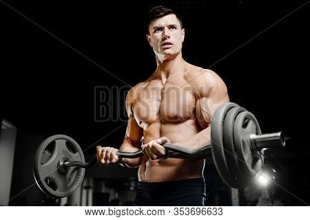 Bodybuilder Strong Man Pumping Up Biceps Muscles