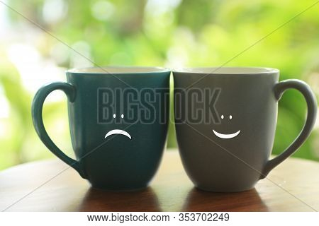 Two Cups Of Tea Or Coffee With Positive And Negative Expressions Sign On It, Cheer Up Your Day Conce