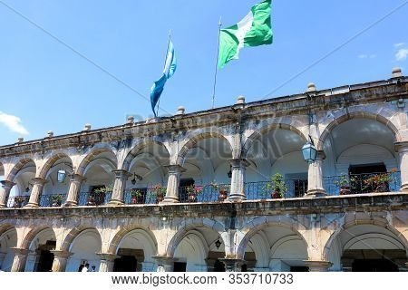 February 25, 2020 In Antigua, Guatemala:  Historical Spanish Colonial Style Adobe Building With Balc