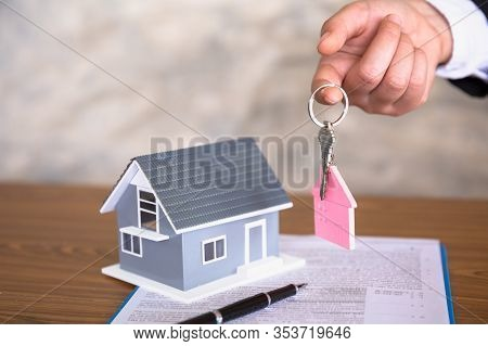 Real Estate Agents Hold Home Keys For Customers. Ideas For Real Estate, Moving Houses Or Renting Rea