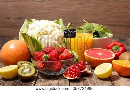 assorted of food high in vitamin c - spinach, strawberry, kiwi, orange, cauliflower