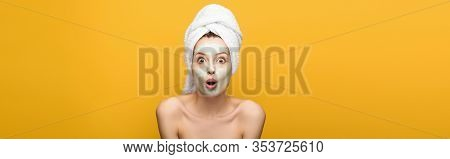 Panoramic Shot Of Shocked Girl With Nourishing Facial Mask And Towel On Head Looking At Camera Isola