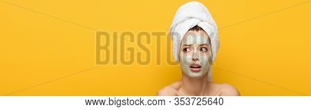 Panoramic Shot With Nourishing Facial Mask And Towel On Head Looking Away Isolated On Yellow