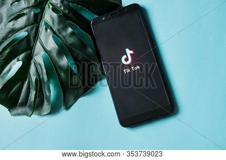 Tver, Russia - February 28, 2020 Tik Tok Logo On Smartphone Screen On Blue Background. Tik Tok Icon.
