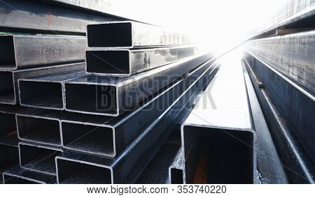 Stack Of Rolled Metal Products Is In A Storage, Steel Pipes Of Rectangular Cross-section, Perspectiv