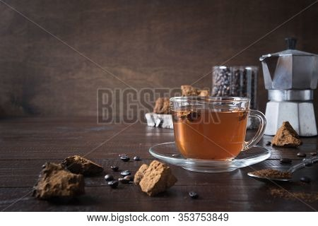 Organic Chaga Mushrooms Coffee In Glass Cup And Coffee Pot. Trendy Healthy Clean Eating Beverage On
