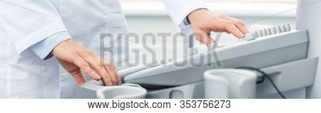 Partial View Of Professional Doctor Working With Ultrasound Scanner In Clinic, Panoramic Shot