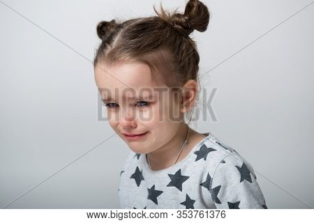 Crying little girl. Upset kid. Sad kid portrait. Cute little girl crying and does not want to go in bed at night