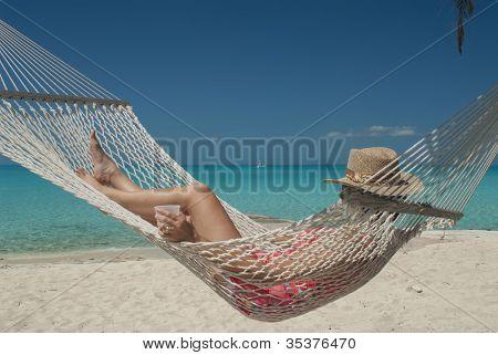 Woman In Hammock On Tropical Beach